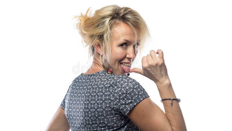 Portret van het grimasing van vrouw van rug stock foto's