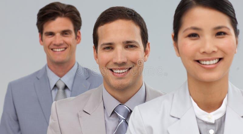 Portret van het jonge businesspeople drie glimlachen royalty-vrije stock afbeeldingen