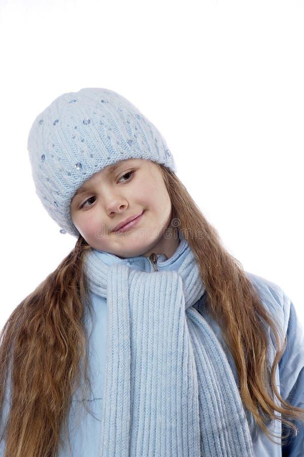 Portret van het meisje in de winterkleren. stock foto
