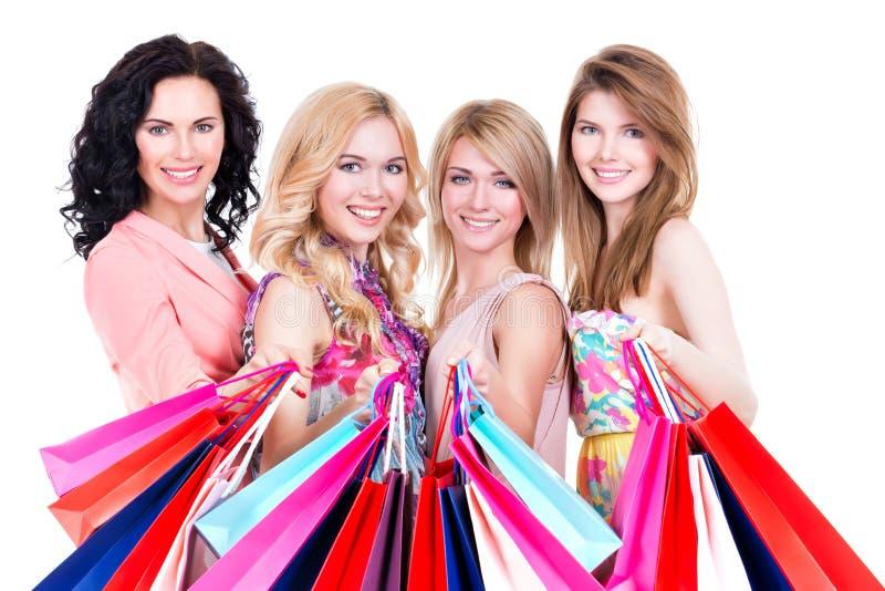 Portret van het mooie gelukkige vrouwen kopen stock foto's