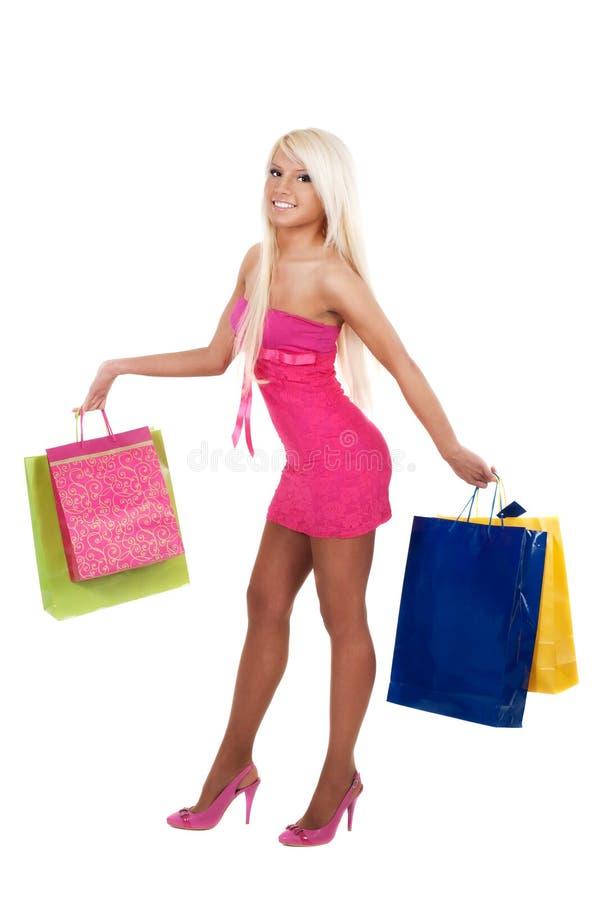 Portret van het overweldigende jonge vrouw het dragen winkelen royalty-vrije stock afbeelding