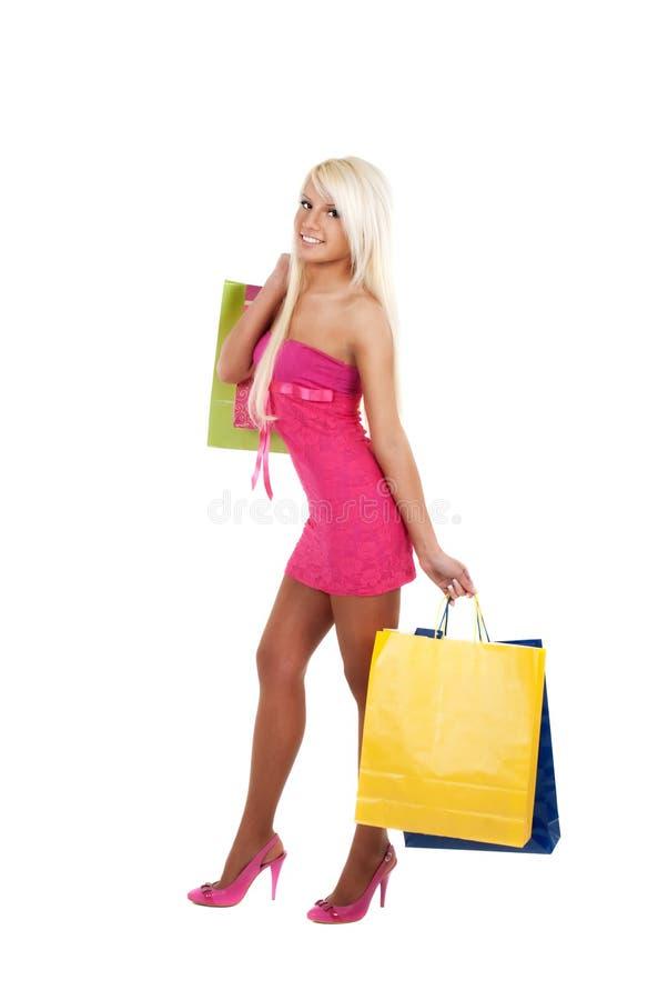 Portret van het overweldigende jonge vrouw het dragen winkelen royalty-vrije stock foto