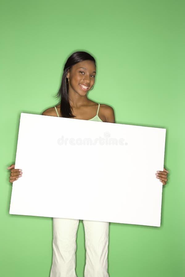 Portret van het teken van de meisjesholding. royalty-vrije stock foto's