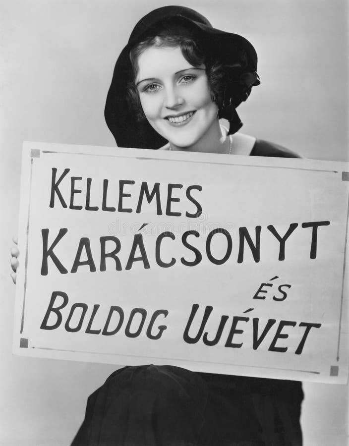 Portret van het teken van de vrouwenholding in vreemde taal wordt geschreven (Alle afgeschilderde personen leven niet langer en g stock afbeelding