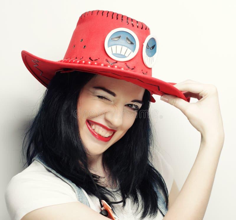 Portret van In Hipster-Meisje in Red Hat stock afbeelding