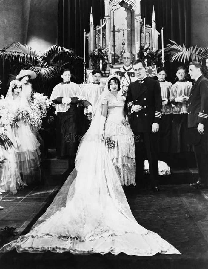Portret van huwelijkspartij bij altaar (Alle afgeschilderde personen leven niet langer en geen landgoed bestaat Leveranciersgaran royalty-vrije stock afbeeldingen