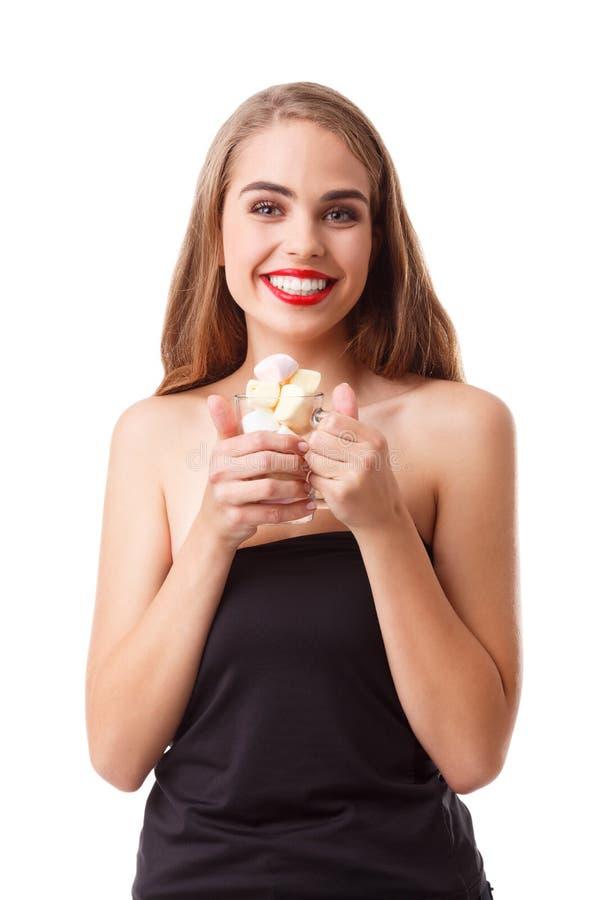 Portret van jonge dame die heemst eten stock afbeeldingen