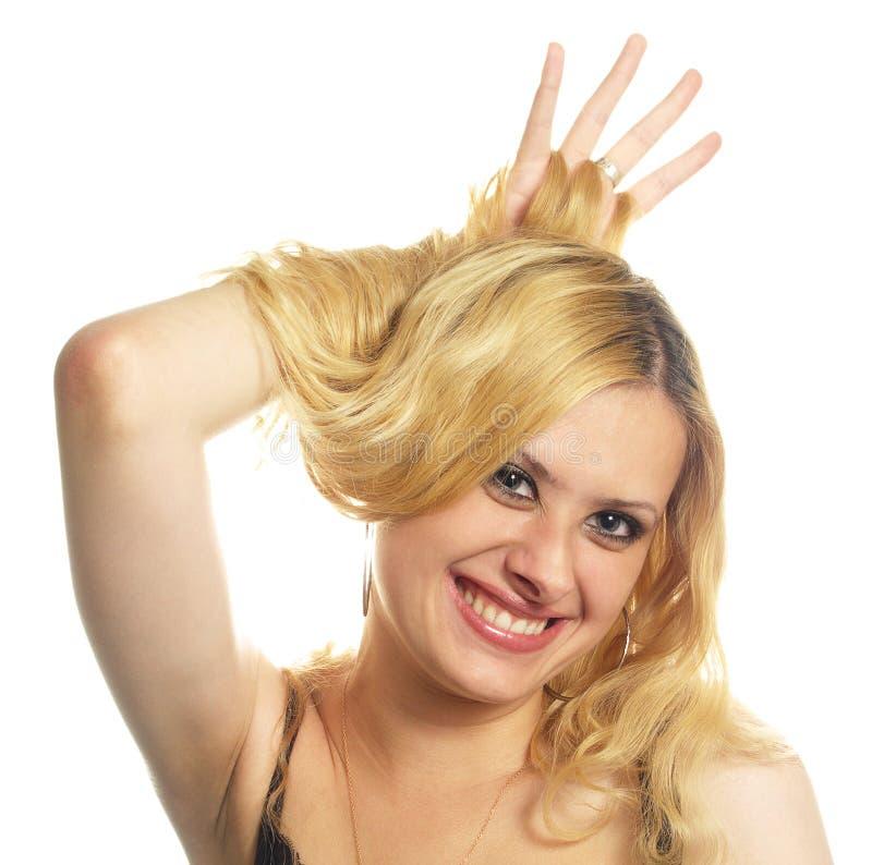 Portret van jonge glimlachende vrouw stock afbeelding