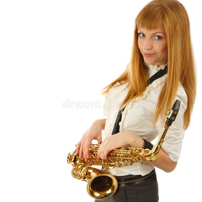 Portret van Jonge glimlachende vrouw met saxofoon stock afbeeldingen