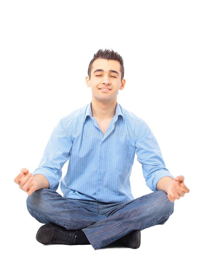 Portret van jonge mens het mediteren stock afbeelding