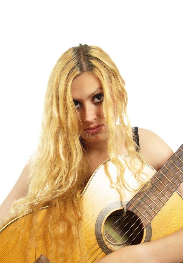 Portret van jonge vrouw met gitaar royalty-vrije stock foto