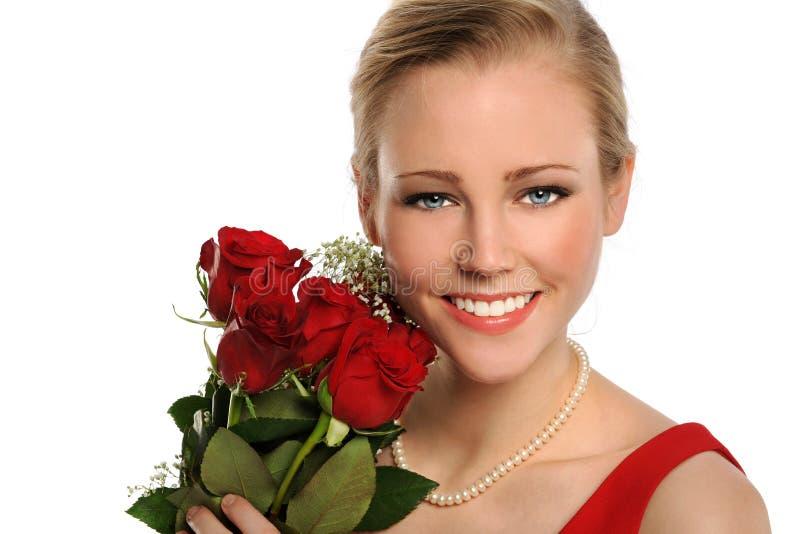 Portret van Jonge Vrouw met Rode Rozen stock afbeeldingen