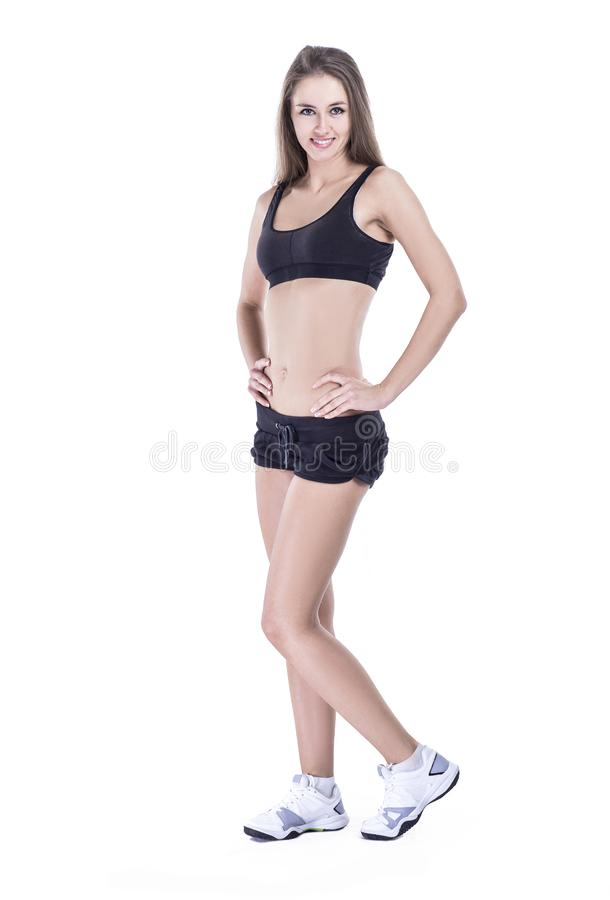 Portret van jonge vrouwelijke geschiktheidsinstructeur in een opleidingskostuum stock afbeeldingen