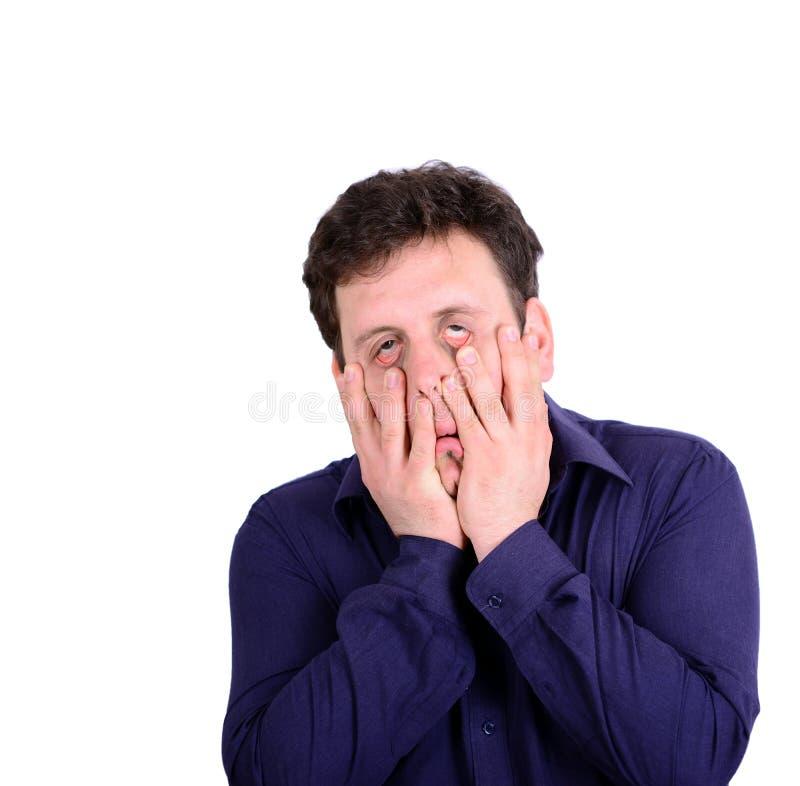 Portret van jonge wanhopige zakenman die zijn gezicht onderaan I trekken stock fotografie