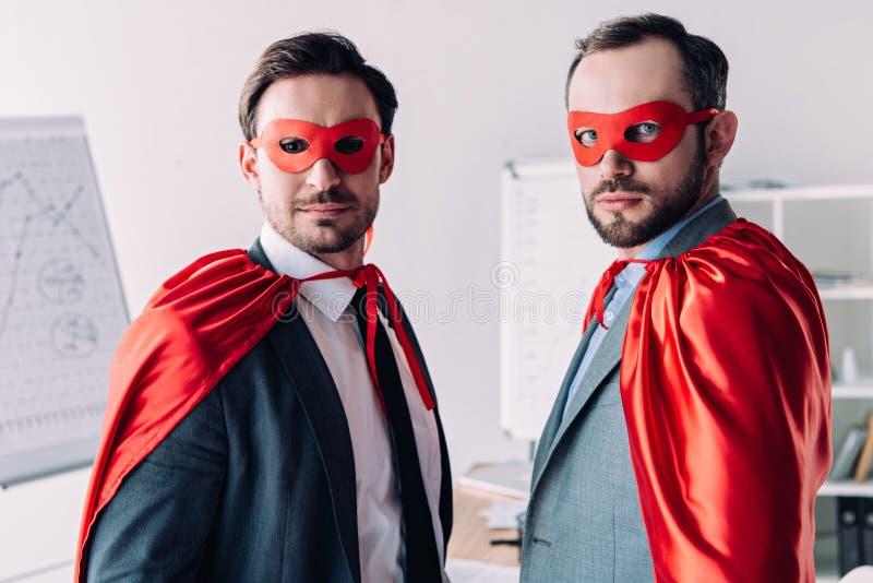 portret van knappe super zakenlieden in maskers en kaap royalty-vrije stock foto's