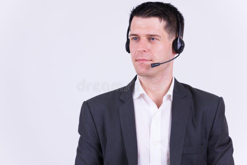 Portret van knappe zakenman als call centre het representatieve denken stock foto's