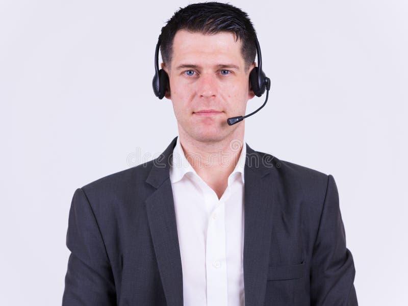 Portret van knappe zakenman als call centrevertegenwoordiger royalty-vrije stock foto
