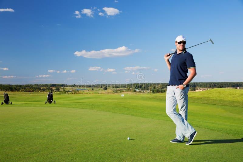 Portret van mannelijke golfspeler stock afbeeldingen