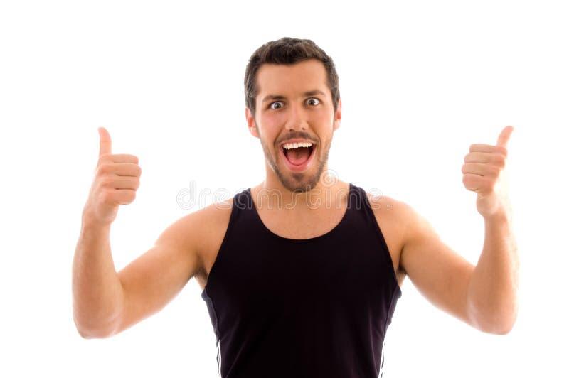 Portret van mannetje met omhoog duimen stock foto's