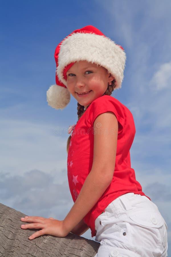 Portret van meisje in de hoed van de Kerstman royalty-vrije stock afbeelding