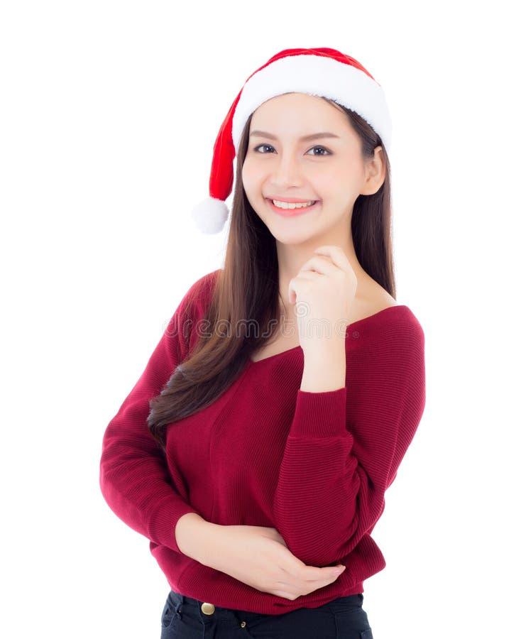 Portret van mooie Aziatische jonge vrouw met gezondheid in santahoed stock foto's