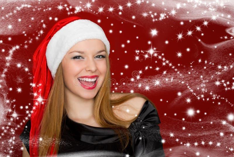 Portret van mooie sexy vrouw in een santahoed stock afbeeldingen