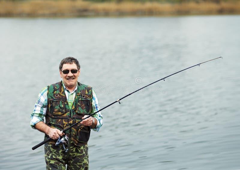 Portret van rijpe visser stock foto