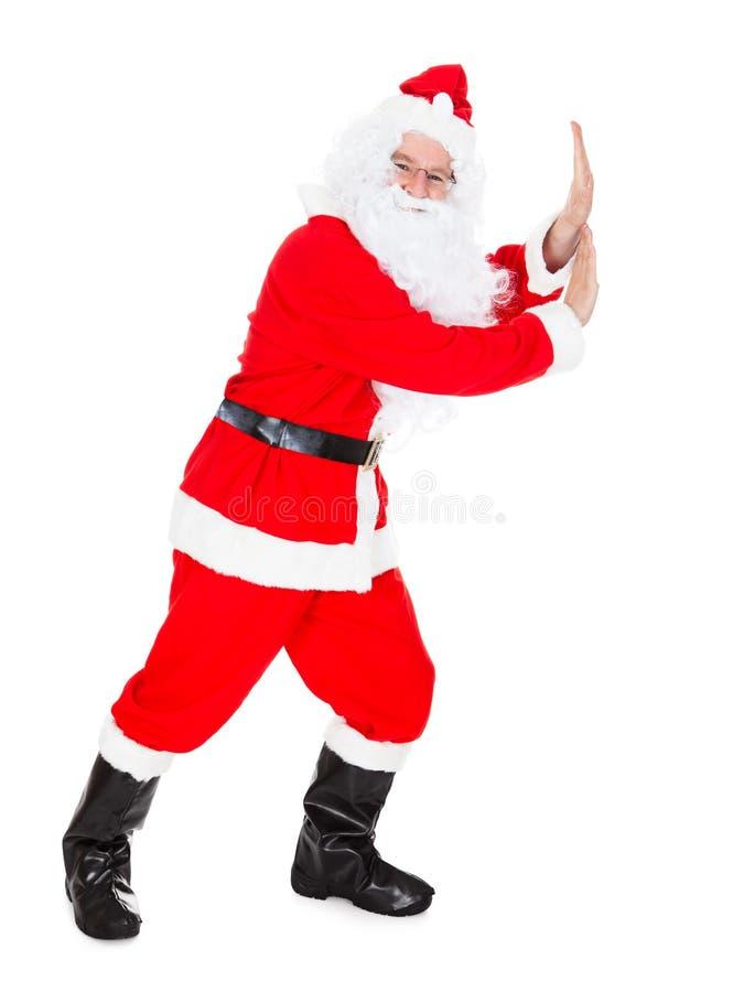 Portret van Santa Claus Pushing royalty-vrije stock fotografie