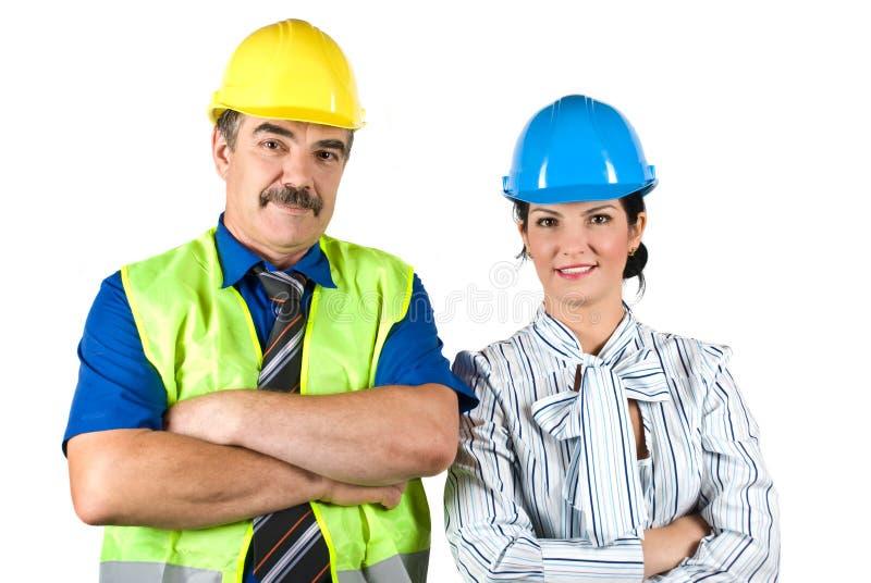 Portret van twee architectenteam met bouwvakker stock foto's