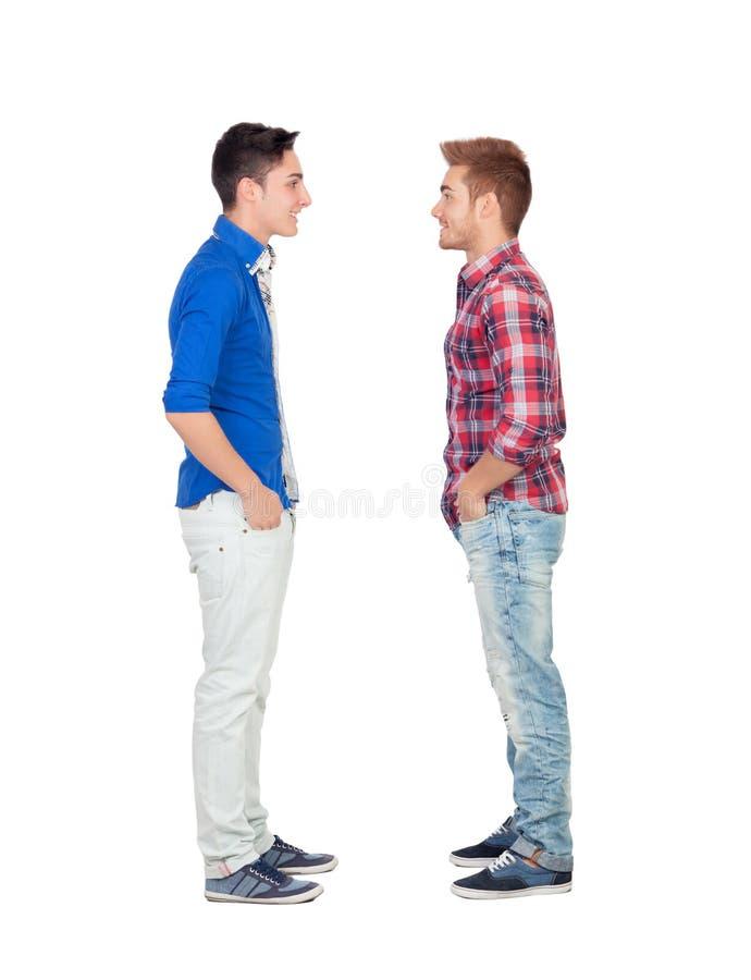 Portret van twee broers face to face stock afbeelding