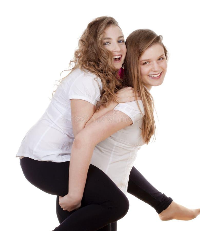 Twee jonge vrouwelijke vrienden stock afbeelding
