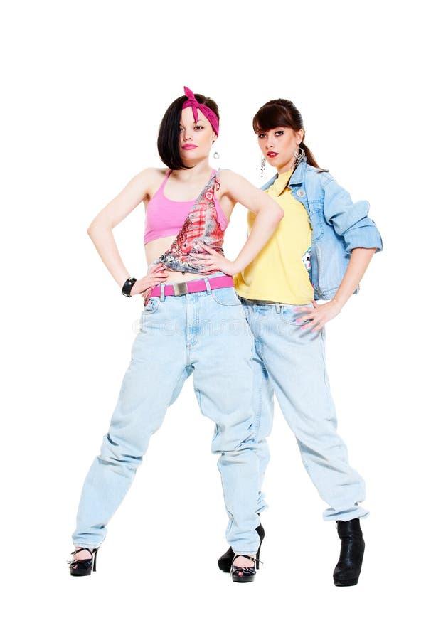 Portret van twee meisjes in jeans royalty-vrije stock afbeeldingen