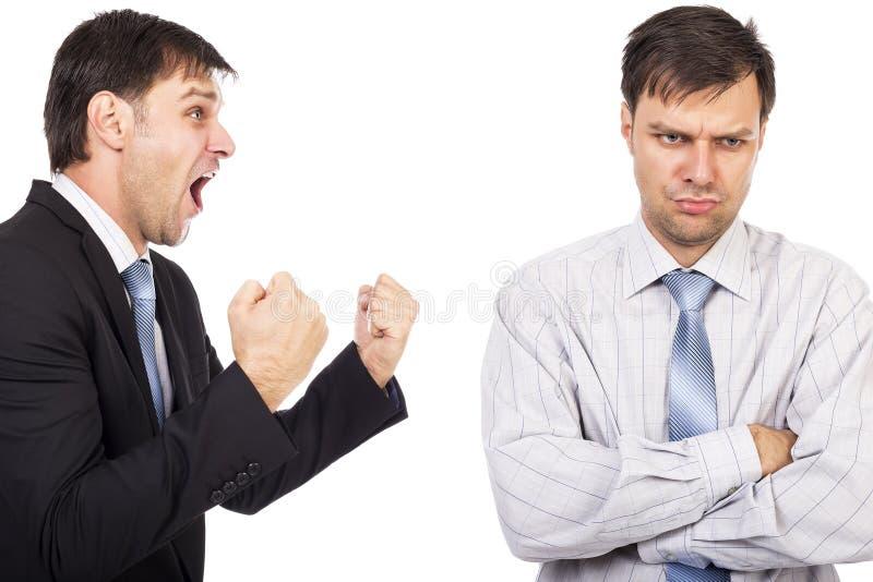 Portret van twee zakenlieden die een confrontatie hebben royalty-vrije stock foto