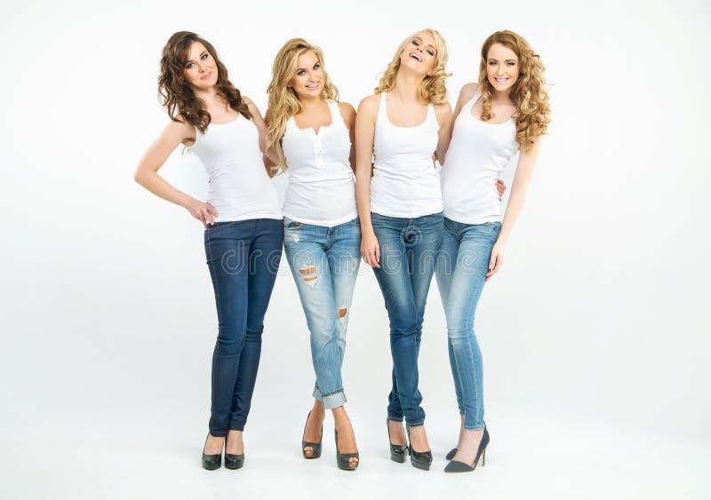 Portret van vier aantrekkelijke dames stock foto's