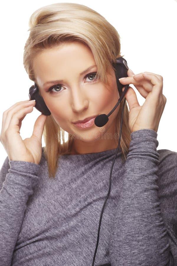 Portret van vriendschappelijke secretaresse/telefoon stock foto