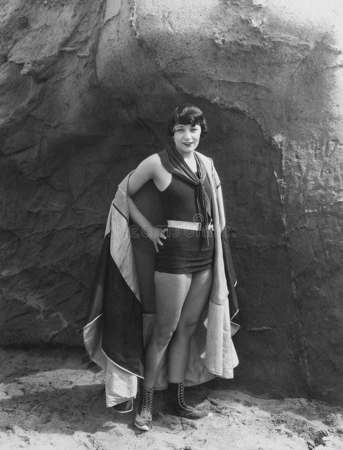 Portret van vrouw die kaap dragen stock foto's
