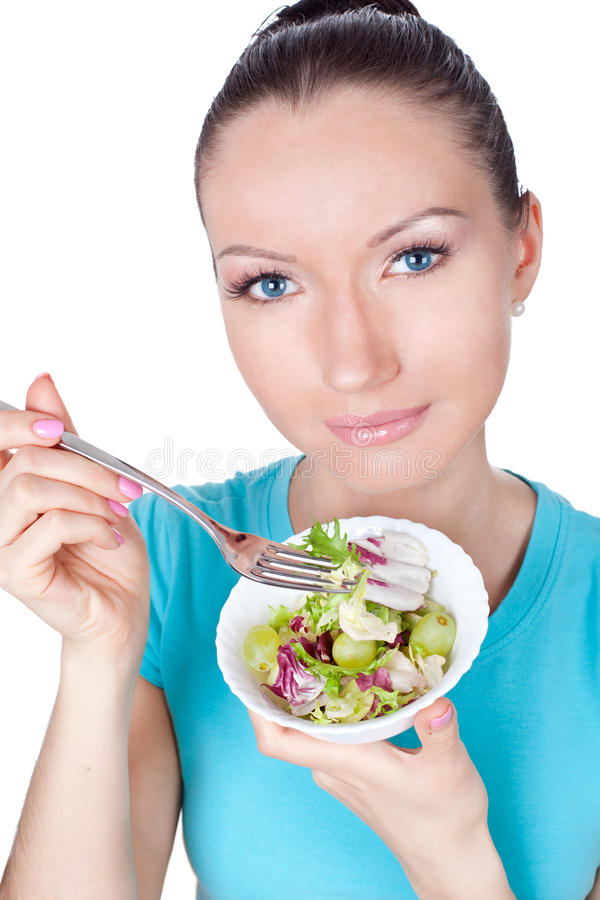 Portret van vrouw die vegetarische salade eet royalty-vrije stock afbeeldingen
