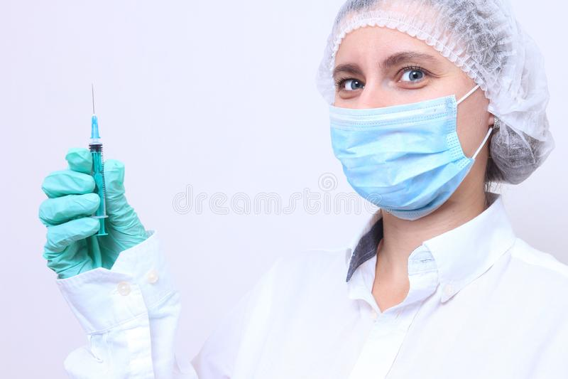 Portret van vrouwelijke arts in masker royalty-vrije stock foto's