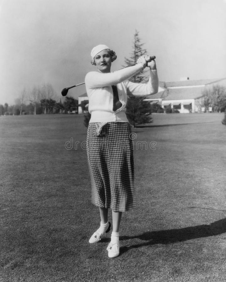 Portret van vrouwelijke golfspeler (Alle afgeschilderde personen leven niet langer en geen landgoed bestaat Leveranciersgaranties stock afbeeldingen