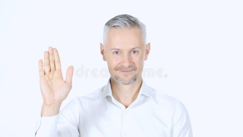 Portret W Średnim Wieku biznesmena falowania ręka, Mówić Cześć, Biały Backgro zdjęcie royalty free