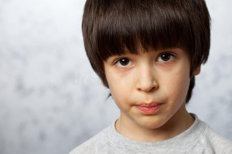 Portret zażarta chłopiec zdjęcie royalty free