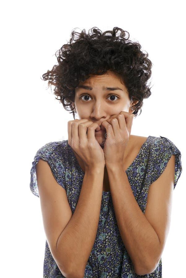 Portret zaakcentowanej kobiety zjadliwy paznokieć obrazy stock