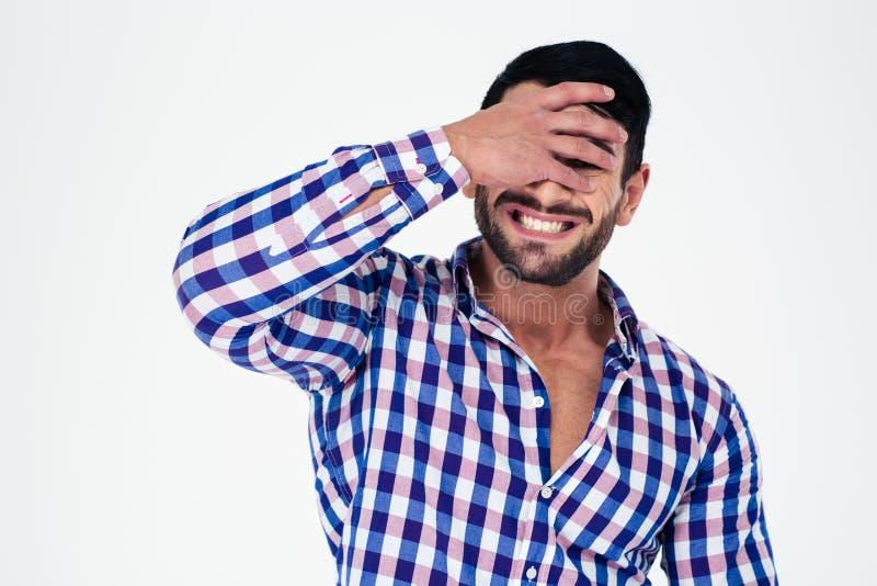 Portret zakrywa jego wzburzony mężczyzna ono przygląda się zdjęcia royalty free