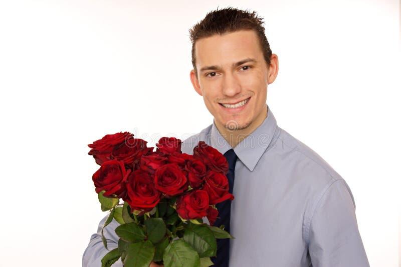Portreta młody człowiek z różami zdjęcia royalty free