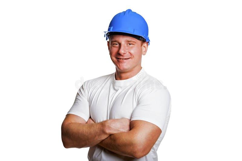 Portriat av mannen med hjälmen, arbetarvitskjorta arkivbilder