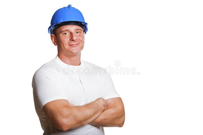 Portriat av mannen med hjälmen, arbetarvitskjorta Korsat beväpnar fotografering för bildbyråer