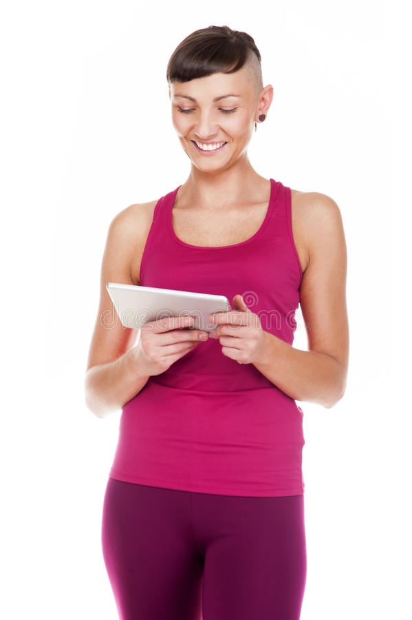 Portriat de la mujer con la tableta, aislado en el fondo blanco SMI foto de archivo
