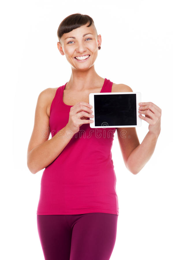 Portriat of fitness woman with tablet. isolated on white background. Showing. stock photo