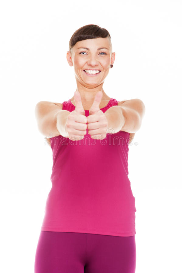 Portriat of fitness woman with thumbs up. Isolated over white ba royalty free stock images