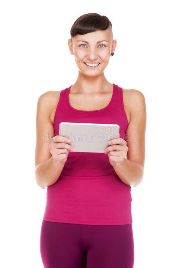 Portriat of woman with tablet, Isolated on white background. Smiling at camera. stock photos
